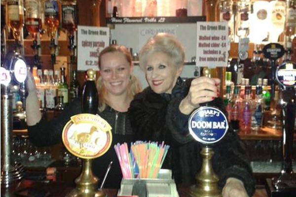 Anita Dobson pulls a pint