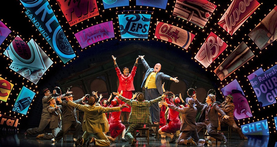 The company performing in 'Guys and Dolls' at the Savoy.